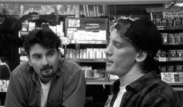 Escriturários Dante e Randall conversando no trabalho