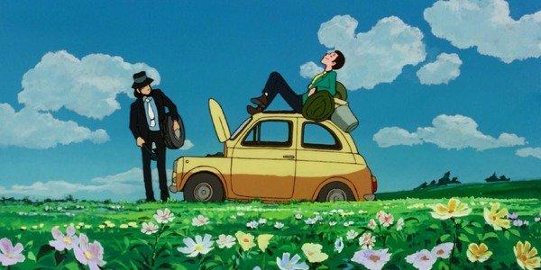 Lupin sentado em um carro em Lupin Terceiro: O Castelo de Cagliostro